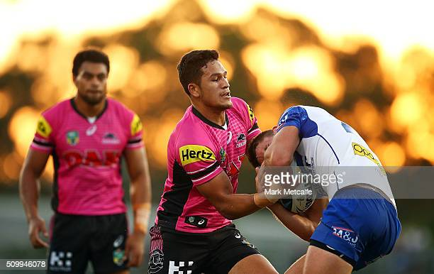 Jarrod McInally of the Bulldogs is tackled by Dallin WateneZelezniak of the Panthers during the NRL Trial match between the Canterbury Bulldogs and...
