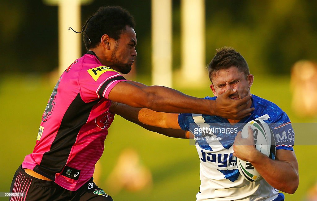 Jarrod McInally of the Bulldogs is tackled by Zach Dockar-Clay of the Panthers during the NRL Trial match between the Canterbury Bulldogs and the Penrith Panthers at Pepper Stadium on February 13, 2016 in Sydney, Australia.