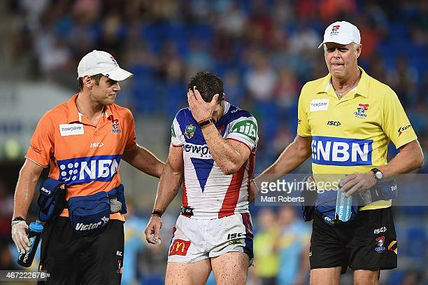 Jarrod Mullen of the Knights is assisted from the field with an injury during the round three NRL match between the Gold Coast Titans and the...