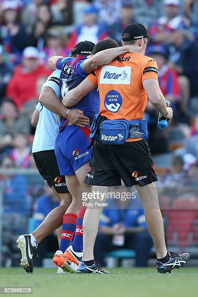 Jarrod Mullen of the Knights is helped from the ground after getting injured during the round eight NRL match between the Newcastle Knights and the...