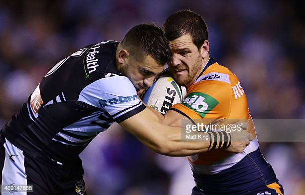 Jarrod Mullen of the Knights is tackled by Jack Bird of the Sharks during the round six NRL match between the Cronulla Sharks and the Newcastle...