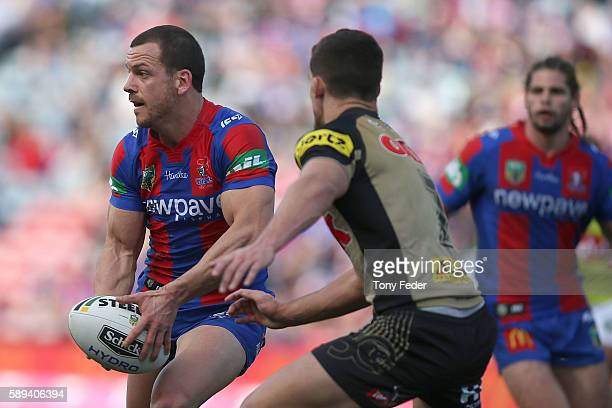 Jarrod Mullen of the Knights is tackled during the round 23 NRL match between the Newcastle Knights and the Penrith Panthers at Hunter Stadium on...
