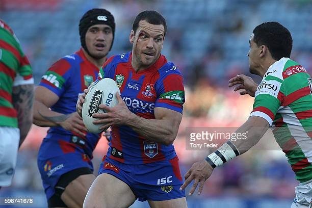 Jarrod Mullen of the Knights is tackled during the round 25 NRL match between the Newcastle Knights and the South Sydney Rabbitohs at Hunter Stadium...