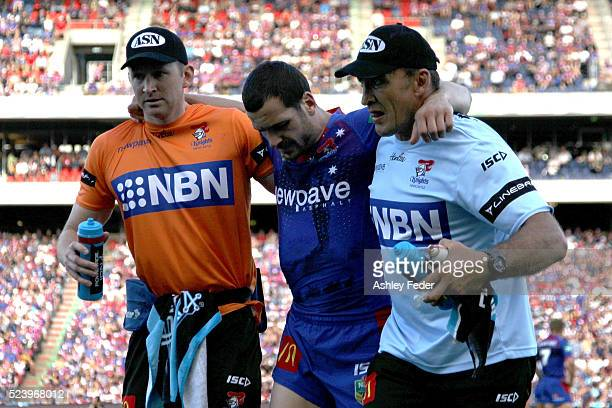 Jarrod Mullen of the Knights is walked off injured during the round eight NRL match between the Newcastle Knights and the Manly Sea Eagles at Hunter...