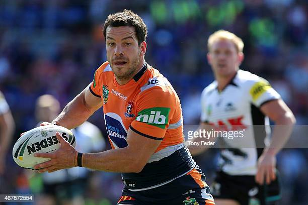 Jarrod Mullen of the Knights looks to pass the ball during the round four NRL match between the Newcastle Knights and the Penrith Panthers at Hunter...