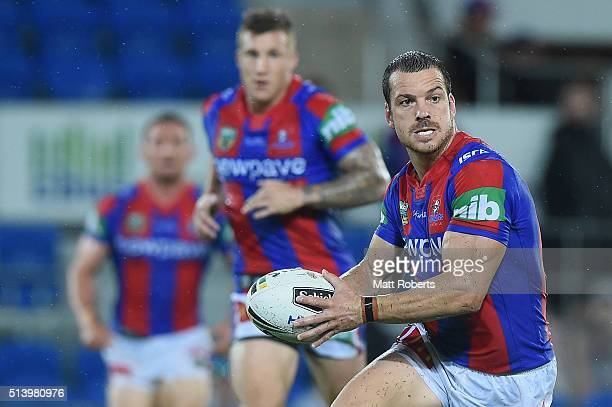 Jarrod Mullen of the Knights looks to pass the ball during the round one NRL match between the Gold Coast Titans and the Newcastle Knights at Cbus...