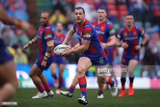 Jarrod Mullen of the Knights looks to pass the ball during the round 22 NRL match between the Newcastle Knights and the Canterbury Bulldogs at Hunter...