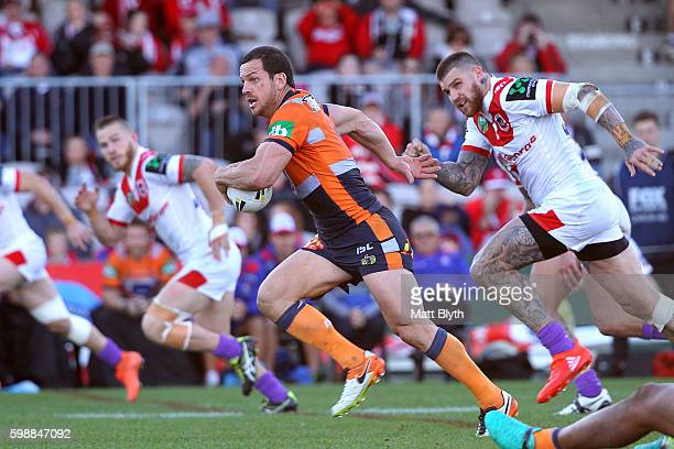 Jarrod Mullen of the Knights makes a break during the round 26 NRL match between the St George Illawarra Dragons and the Newcastle Knights at WIN...