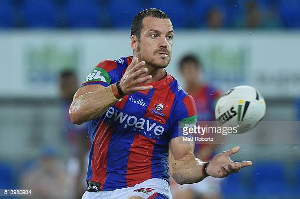 Jarrod Mullen of the Knights passes the ball during the round one NRL match between the Gold Coast Titans and the Newcastle Knights at Cbus Super...