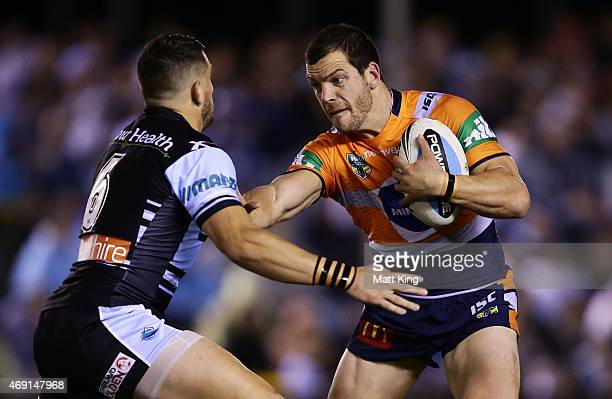 Jarrod Mullen of the Knights puts a fend on Jack Bird of the Sharks during the round six NRL match between the Cronulla Sharks and the Newcastle...