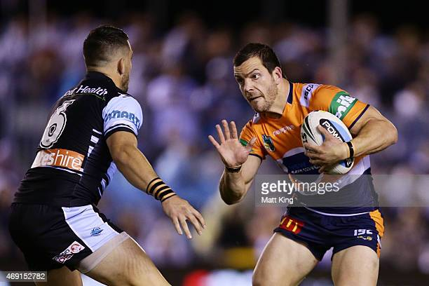 Jarrod Mullen of the Knights runs at Jack Bird of the Sharks during the round six NRL match between the Cronulla Sharks and the Newcastle Knights at...