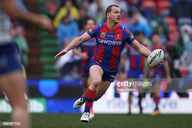 Jarrod Mullen of the Knights runs the ball during the round 22 NRL match between the Newcastle Knights and the Canterbury Bulldogs at Hunter Stadium...