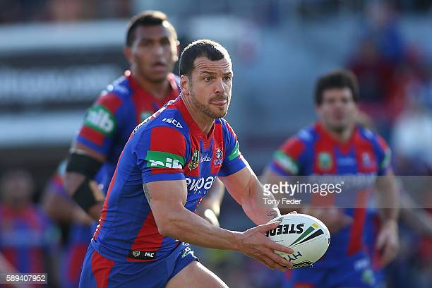 Jarrod Mullen of the Knights runs the ball during the round 23 NRL match between the Newcastle Knights and the Penrith Panthers at Hunter Stadium on...