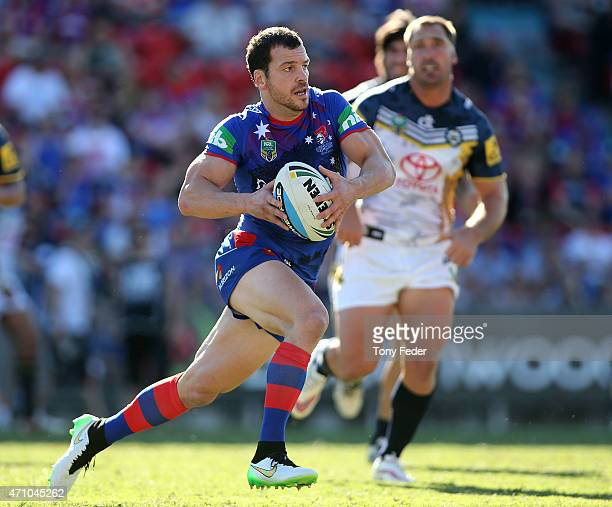 Jarrod Mullen of the Knights runs the ball during the round eight NRL match between the Newcastle Knights and the North Queensland Cowboys at Hunter...