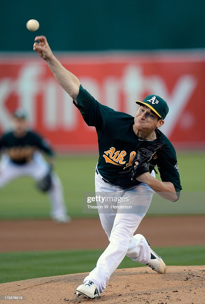<a gi-track='captionPersonalityLinkClicked' href=/galleries/search?phrase=Jarrod+Parker&family=editorial&specificpeople=5970942 ng-click='$event.stopPropagation()'>Jarrod Parker</a> #11 of the Oakland Athletics pitches against the Boston Red Sox at O.co Coliseum on July 12, 2013 in Oakland, California.