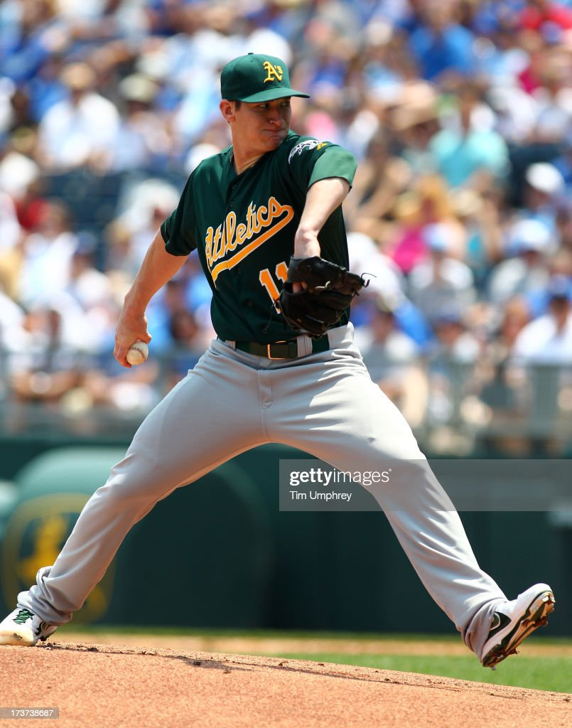 <a gi-track='captionPersonalityLinkClicked' href=/galleries/search?phrase=Jarrod+Parker&family=editorial&specificpeople=5970942 ng-click='$event.stopPropagation()'>Jarrod Parker</a> #11 of the Oakland Athletics pitches against the Kansas City Royals at Kauffman Stadium on July 6, 2013 in Kansas City, Missouri. The Royals defeated the Athletics 4-3.