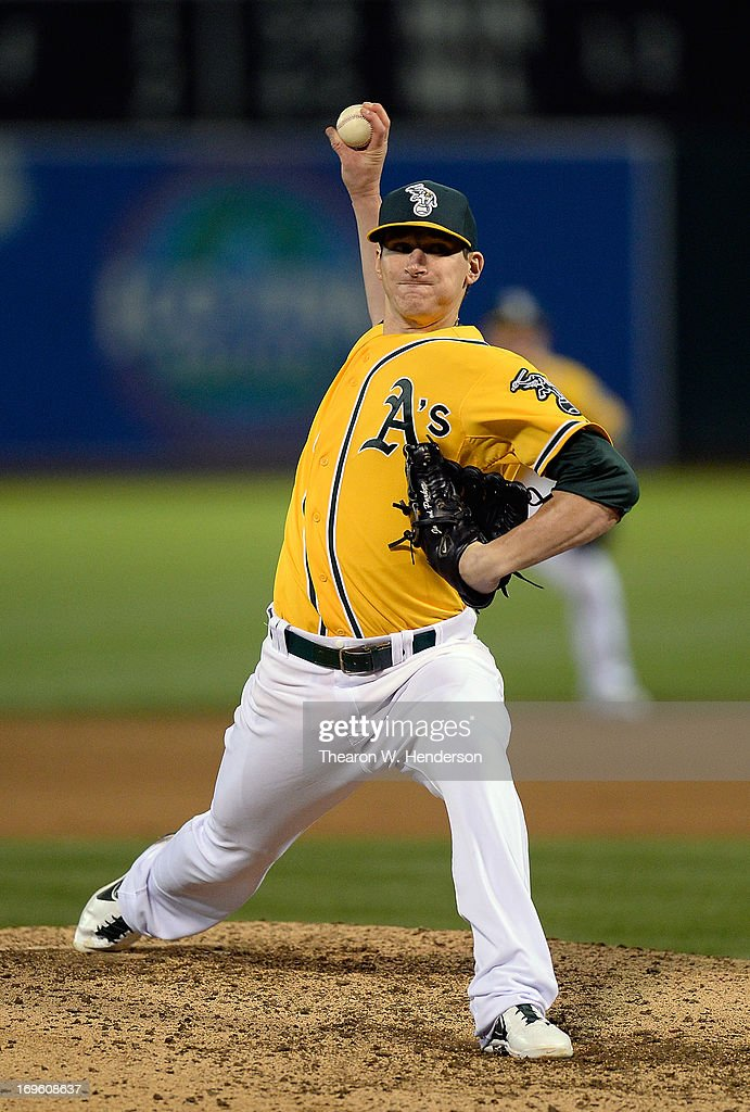 <a gi-track='captionPersonalityLinkClicked' href=/galleries/search?phrase=Jarrod+Parker&family=editorial&specificpeople=5970942 ng-click='$event.stopPropagation()'>Jarrod Parker</a> #11 of the Oakland Athletics pitches against the San Francisco Giants in the six inning at O.co Coliseum on May 28, 2013 in Oakland, California.