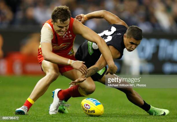 Jarrod Pickett of the Blues and Kade Kolodjashnij of the Suns in action during the 2017 AFL round 04 match between the Carlton Blues and the Gold...