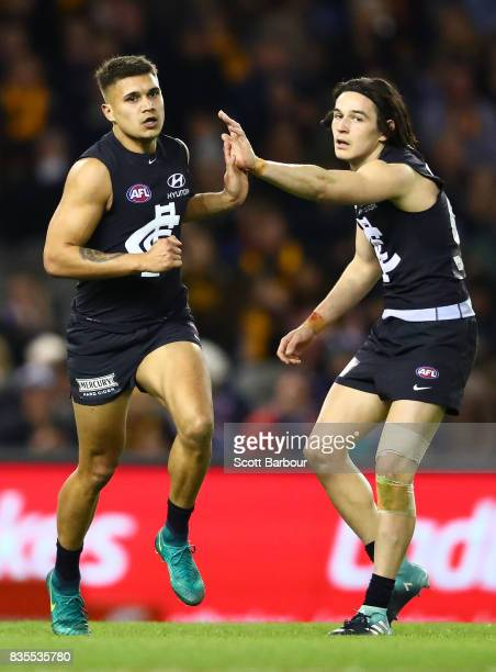 Jarrod Pickett of the Blues is congratulated by Zac Fisher of the Blues after kicking a goal during the round 22 AFL match between the Carlton Blues...
