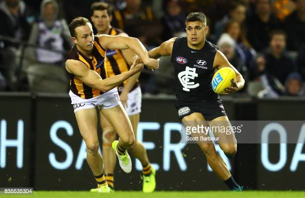 Jarrod Pickett of the Blues runs with the ball during the round 22 AFL match between the Carlton Blues and the Hawthorn Hawks at Etihad Stadium on...