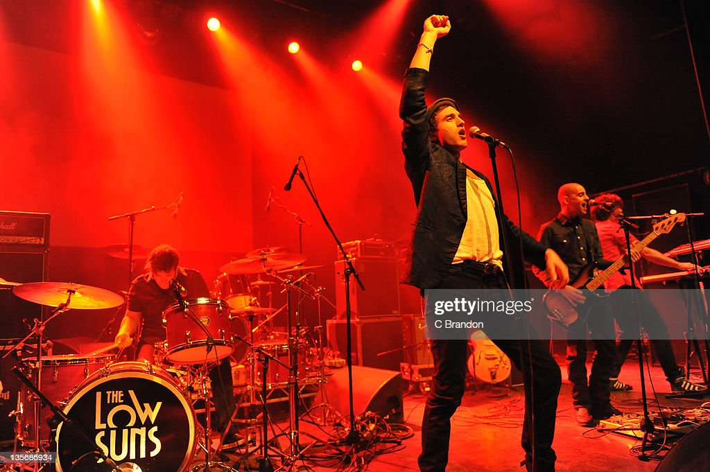 Jarrod Pizzata, Jack Berkley, Si Clark and James Durrant of The Low Suns performs on stage at Shepherds Bush Empire on December 12, 2011 in London, United Kingdom.