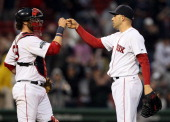 Jarrod Saltalamacchia and Alfredo Aceves of the Boston Red Sox celebrate the win over the Seattle Mariners on May 15 2012 at Fenway Park in Boston...