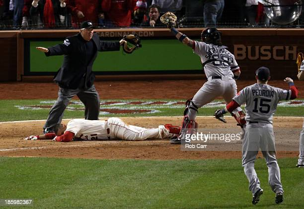 Jarrod Saltalamacchia and Dustin Pedroia of the Boston Red Sox react as Home Plate Umpire Dana DeMuth calls Allen Craig of the St Louis Cardinals...