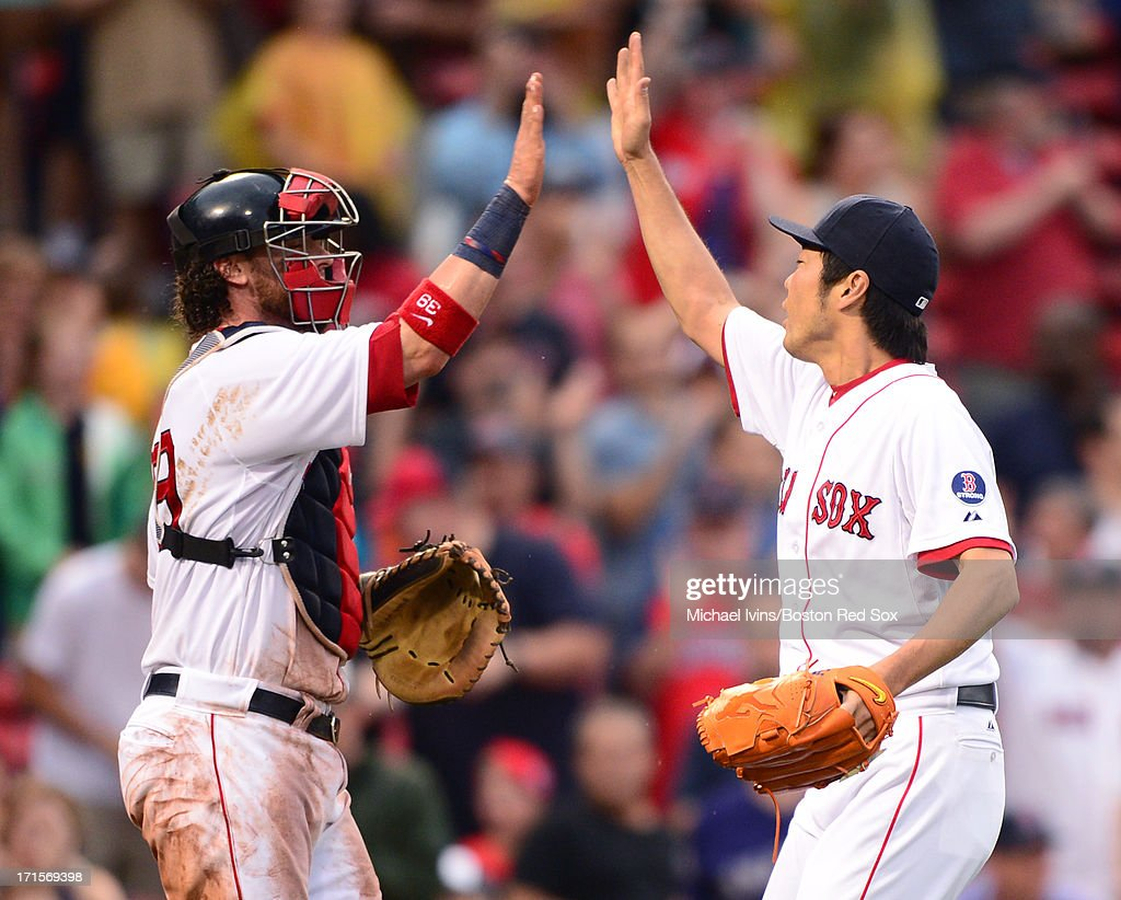 Jarrod Saltalamacchia #39 and Koji Uehara #19 of the Boston Red Sox celebrate a 5-3 win against the Colorado Rockies on June 26, 2013 at Fenway Park in Boston, Massachusetts.