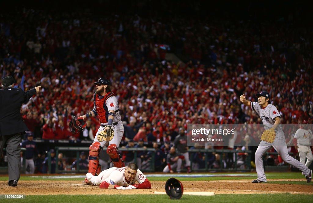 Jarrod Saltalamacchia and Koji Uehara of the Boston Red Sox react as Home Plate Umpire Dana DeMuth calls Allen Craig of the St Louis Cardinals safe...