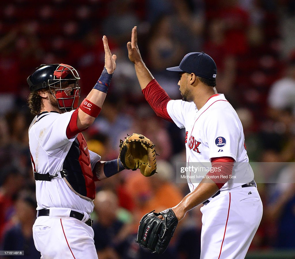 Jarrod Saltalamacchia and Pedro Beato of the Boston Red Sox celebrate an 114 win against the Colorado Rockies on June 25 2013 at Fenway Park in...