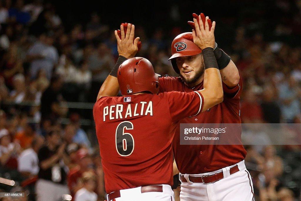 Jarrod Saltalamacchia of the Arizona Diamondbacks highfives David Peralta after hitting a tworun home run against the San Francisco Giants during the...