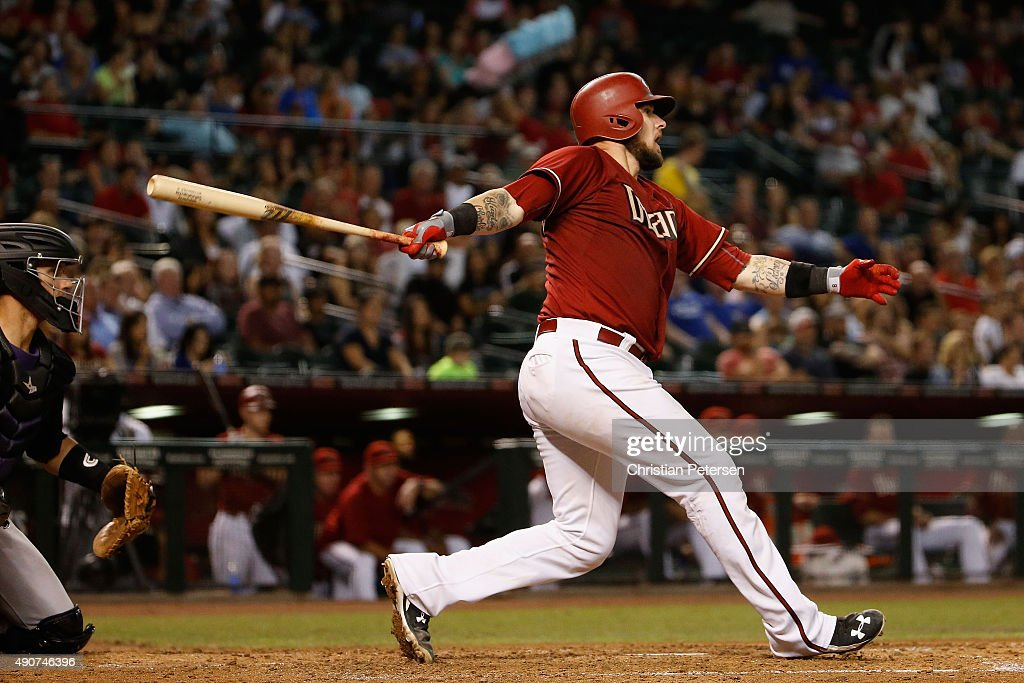 Jarrod Saltalamacchia #8 of the Arizona Diamondbacks hits a RBI single against the Colorado Rockies during the sixth inning of the MLB game at Chase Field on September 30, 2015 in Phoenix, Arizona.
