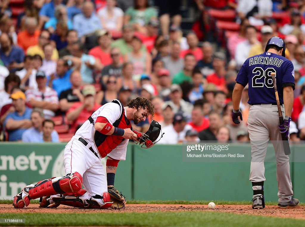 Jarrod Saltalamacchia #39 of the Boston Red reacts after being struck by a foul ball off the bat of Nolan Arenado #28 of the Colorado Rockies in the fourth inning on June 26, 2013 at Fenway Park in Boston, Massachusetts.