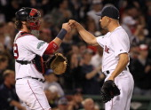 Jarrod Saltalamacchia of the Boston Red Sox and Alfredo Aceves celebrate their 51 win over Toronto Blue Jays at Fenway Park June 26 2012 in Boston...