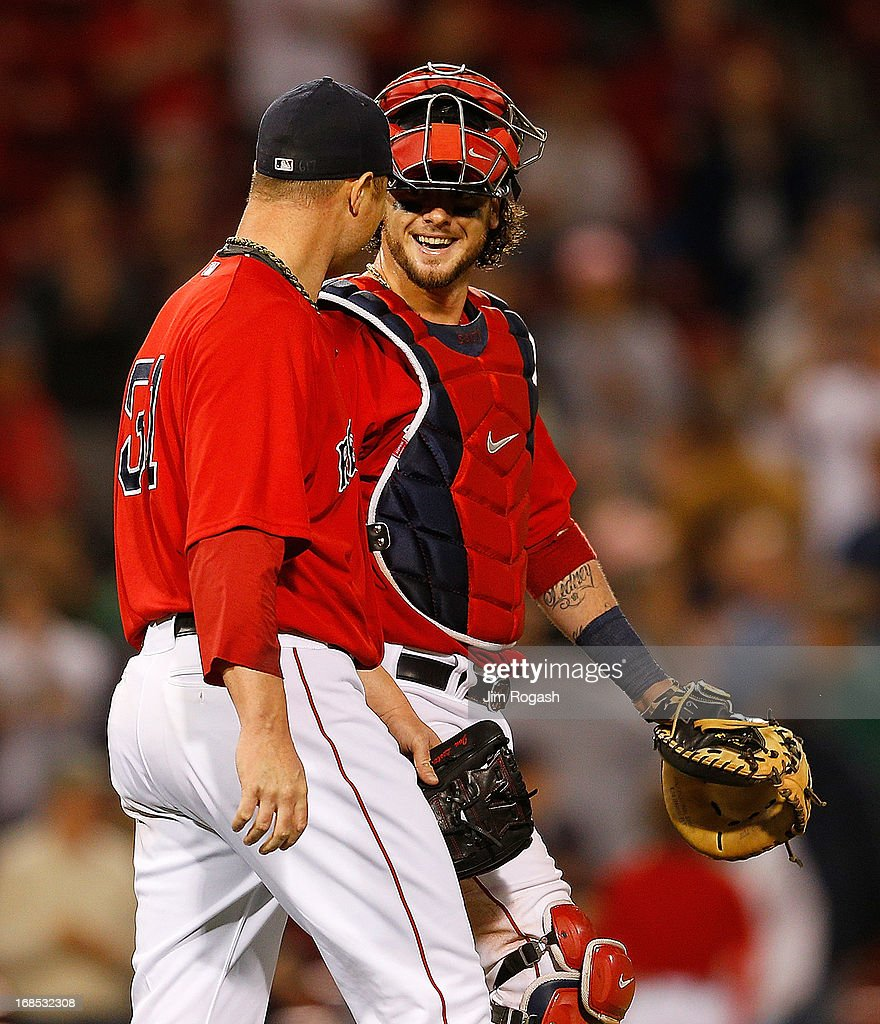 <a gi-track='captionPersonalityLinkClicked' href=/galleries/search?phrase=Jarrod+Saltalamacchia&family=editorial&specificpeople=836404 ng-click='$event.stopPropagation()'>Jarrod Saltalamacchia</a> #39 of the Boston Red Sox and <a gi-track='captionPersonalityLinkClicked' href=/galleries/search?phrase=Jon+Lester&family=editorial&specificpeople=832746 ng-click='$event.stopPropagation()'>Jon Lester</a> #31 react after throwing a one-hit shutout against the Toronto Blue Jays at Fenway Park on May 10, 2013 in Boston, Massachusetts.