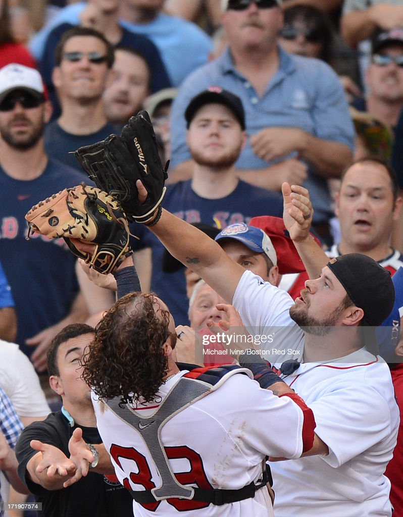 <a gi-track='captionPersonalityLinkClicked' href=/galleries/search?phrase=Jarrod+Saltalamacchia&family=editorial&specificpeople=836404 ng-click='$event.stopPropagation()'>Jarrod Saltalamacchia</a> #39 of the Boston Red Sox catches a foul ball in the stands against the Toronto Blue Jays in the eighth inning on June 29, 2013 at Fenway Park in Boston, Massachusetts.