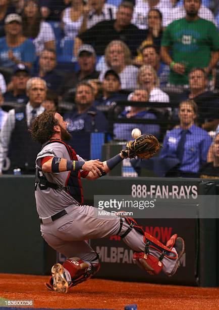 Jarrod Saltalamacchia of the Boston Red Sox catches a foul ball in the eighth inning against the Tampa Bay Rays during Game Three of the American...