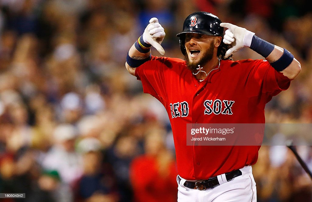 Jarrod Saltalamacchia #39 of the Boston Red Sox celebrates after hitting a grand-slam home run in the 7th inning against the New York Yankees during the game on September 13, 2013 at Fenway Park in Boston, Massachusetts.