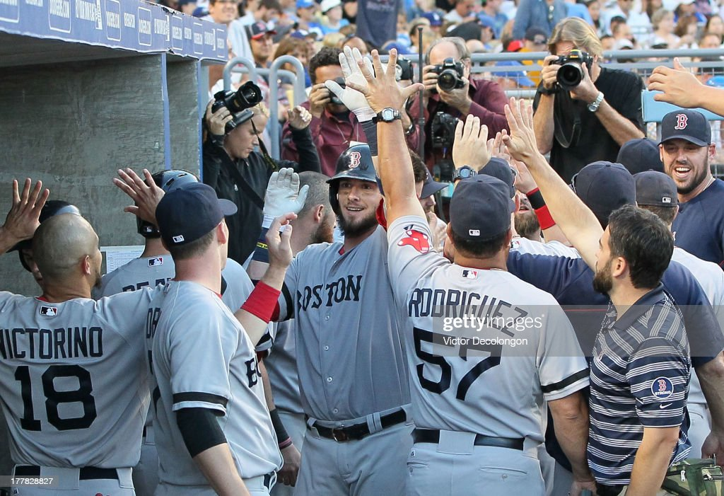 <a gi-track='captionPersonalityLinkClicked' href=/galleries/search?phrase=Jarrod+Saltalamacchia&family=editorial&specificpeople=836404 ng-click='$event.stopPropagation()'>Jarrod Saltalamacchia</a> #39 of the Boston Red Sox celebrates with teammates in the dugout after hitting a two-run home run driving in Mike Napoli #12 (not in photo) in the sixth inning during their MLB game against the Los Angeles Dodgers at Dodger Stadium on August 25, 2013 in Los Angeles, California. The Red Sox defeated the Dodgers 8-1.