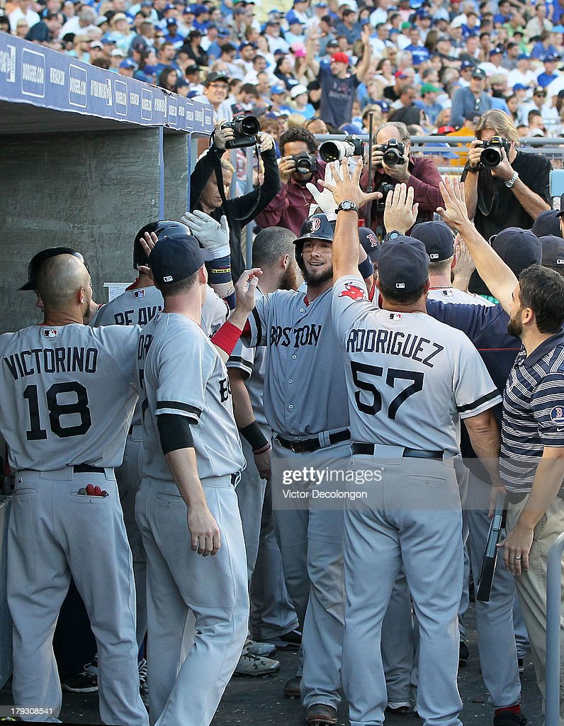 <a gi-track='captionPersonalityLinkClicked' href=/galleries/search?phrase=Jarrod+Saltalamacchia&family=editorial&specificpeople=836404 ng-click='$event.stopPropagation()'>Jarrod Saltalamacchia</a> #39 of the Boston Red Sox (center) celebrates with teammates in the dugout after hitting a two-run home run driving in Mike Napoli #12 (not in photo) in the sixth inning during their MLB game against the Los Angeles Dodgers at Dodger Stadium on August 25, 2013 in Los Angeles, California. The Red Sox defeated the Dodgers 8-1.