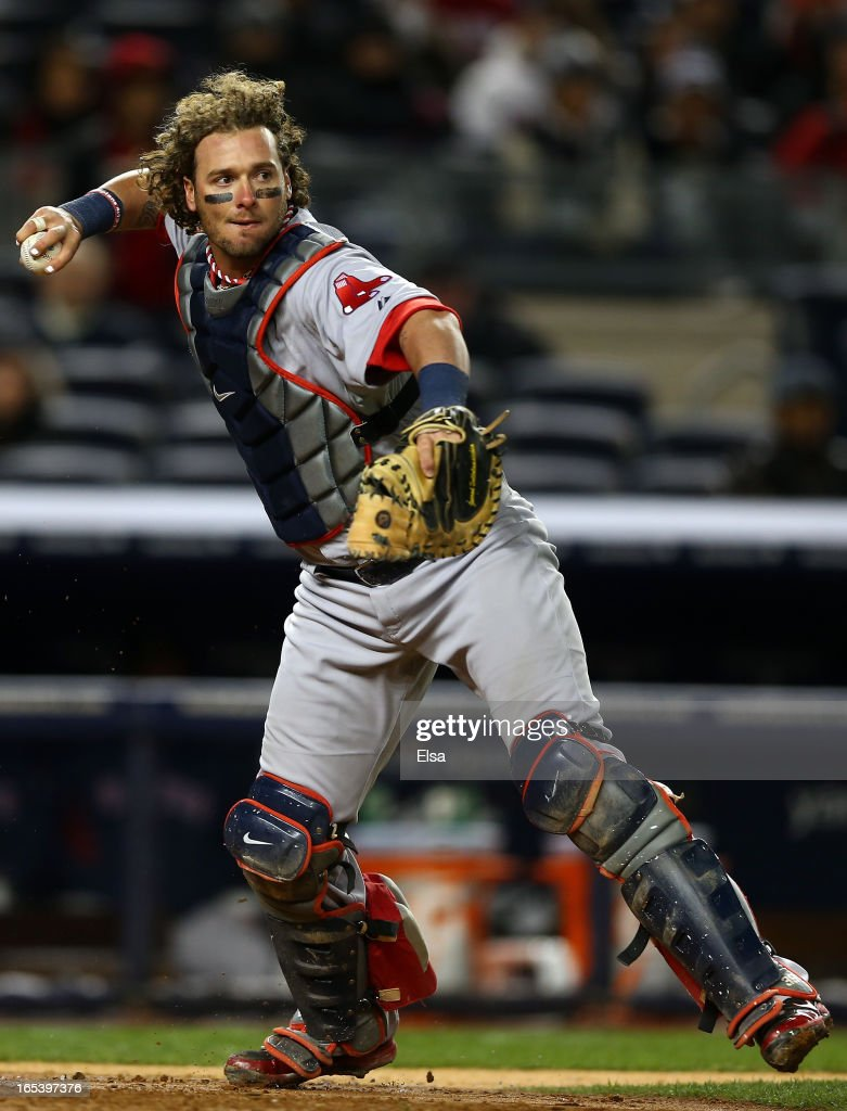 <a gi-track='captionPersonalityLinkClicked' href=/galleries/search?phrase=Jarrod+Saltalamacchia&family=editorial&specificpeople=836404 ng-click='$event.stopPropagation()'>Jarrod Saltalamacchia</a> #39 of the Boston Red Sox fields a hit by Travis Hafner of the New York Yankees for the out on April 3, 2013 at Yankee Stadium in the Bronx borough of New York City.