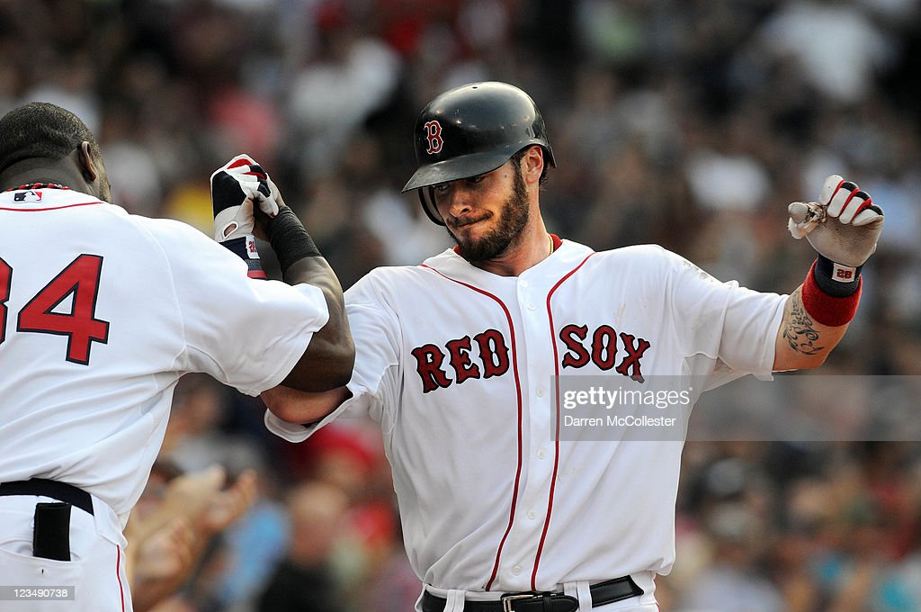 Jarrod Saltalamacchia # 39 of the Boston Red Sox gets congratulated after hitting a two run homer in the fourth inning against the Texas Rangers at Fenway Park on September 3, 2011 in Boston, Massachusetts.