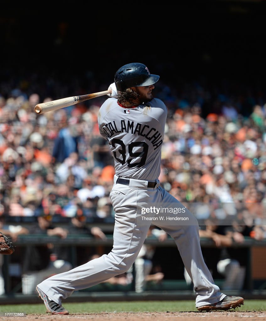 <a gi-track='captionPersonalityLinkClicked' href=/galleries/search?phrase=Jarrod+Saltalamacchia&family=editorial&specificpeople=836404 ng-click='$event.stopPropagation()'>Jarrod Saltalamacchia</a> #39 of the Boston Red Sox hits a bases loaded two-run rbi single in the seventh inning against the San Francisco Giants at AT&T Park on August 21, 2013 in San Francisco, California. Jacoby Ellsbury #2 and Dustin Pedroia #15 scored on the single.