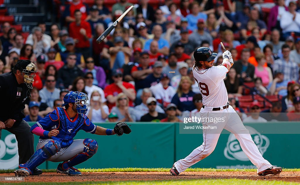 Jarrod Saltalamacchia #39 of the Boston Red Sox hits a broken bat single against the Toronto Blue Jays during the game on May 12, 2013 at Fenway Park in Boston, Massachusetts.