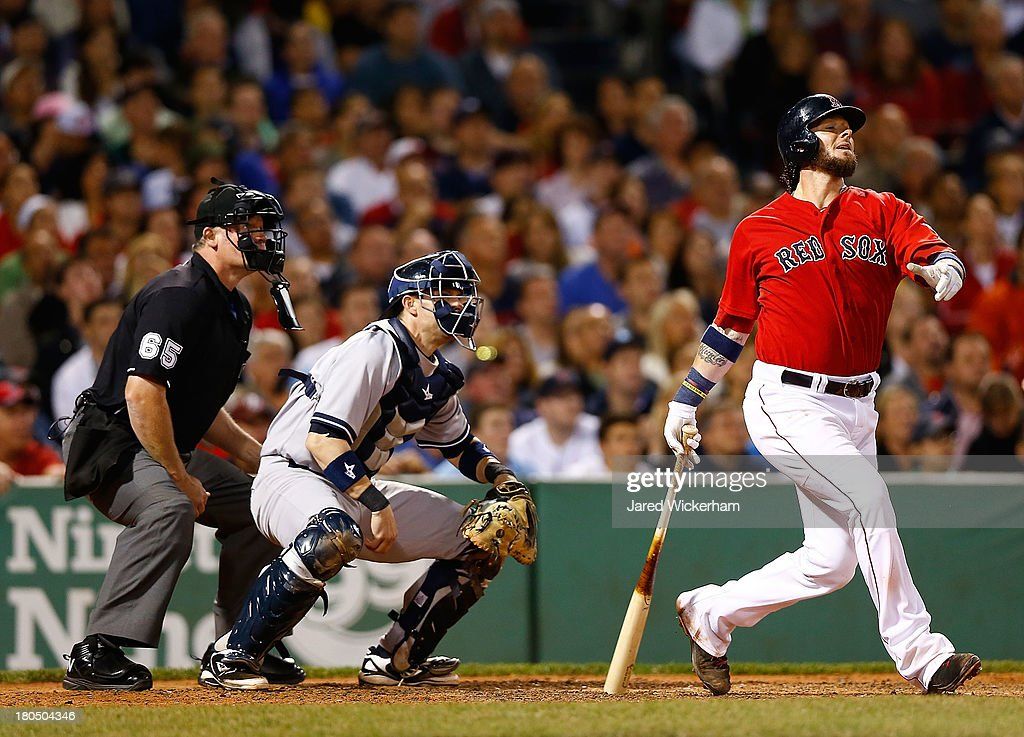 Jarrod Saltalamacchia #39 of the Boston Red Sox hits a grand-slam home run in the 7th inning against the New York Yankees during the game on September 13, 2013 at Fenway Park in Boston, Massachusetts.