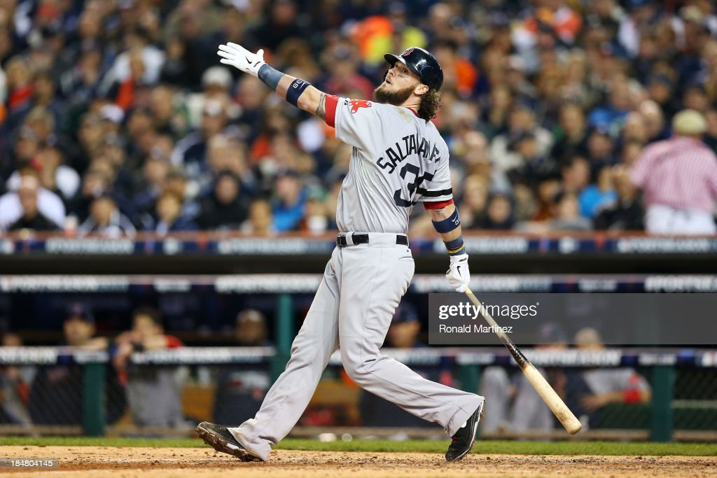 Jarrod Saltalamacchia of the Boston Red Sox hits a RBI single scoring Mike Napoli in the sixth inning against the Detroit Tigers during Game Four of...