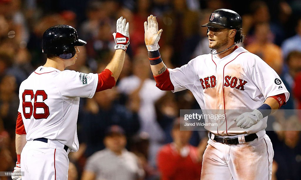 Jarrod Saltalamacchia #39 of the Boston Red Sox is congratulated by teammate Daniel Nava #66 after hitting a solo home run in the 9th inning against the New York Yankees during the game on September 12, 2012 at Fenway Park in Boston, Massachusetts.