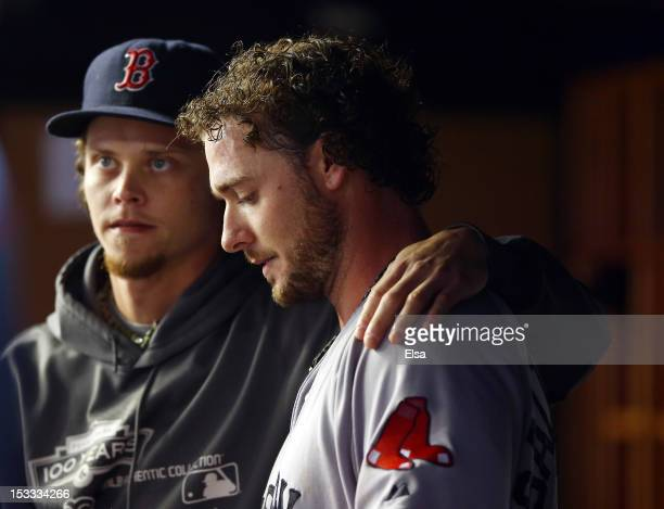 Jarrod Saltalamacchia of the Boston Red Sox is consoled by teammate Clay Buchholz after the loss to the New York Yankees on October 3 2012 at Yankee...