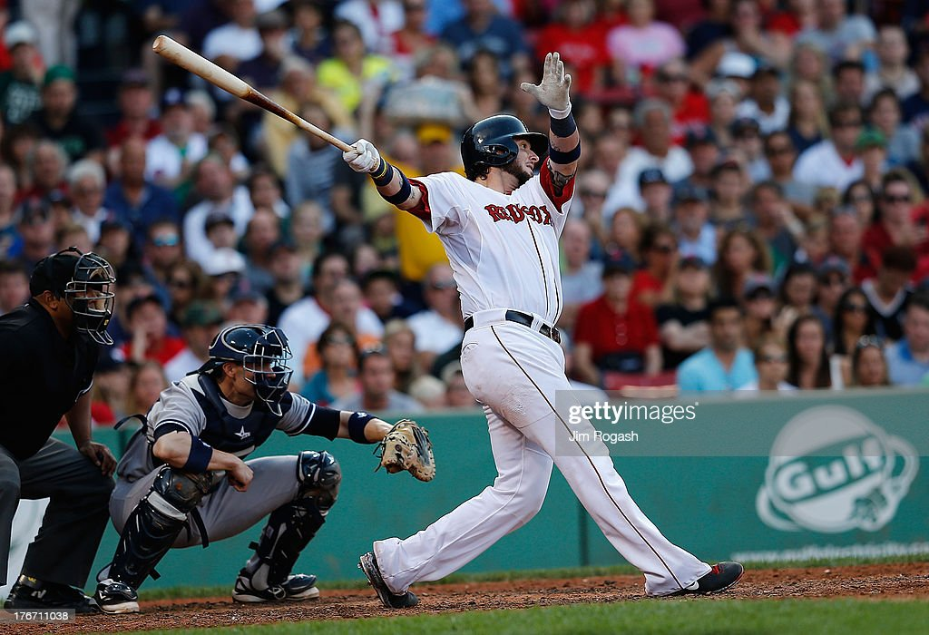 Jarrod Saltalamacchia #39 of the Boston Red Sox knocks in a run in the 6th inning against the New York Yankees at Fenway Park on August 17, 2013 in Boston, Massachusetts.