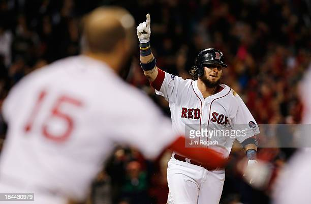 Jarrod Saltalamacchia of the Boston Red Sox reacts after hitting a gamewinning single against the Detroit Tigers to win 65 in Game Two of the...